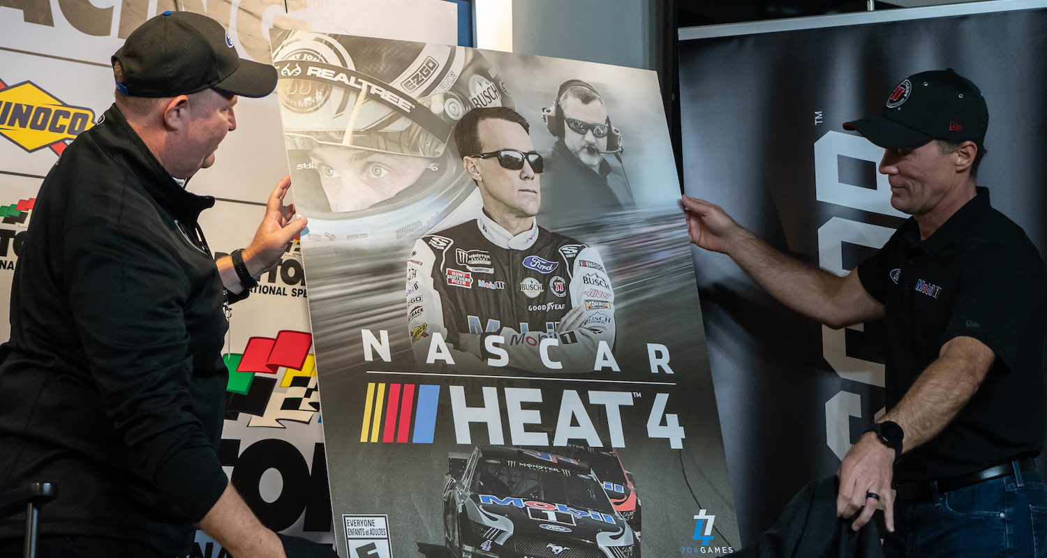 Kevin Harvick unveils the new NASCAR Heat 4 cover.